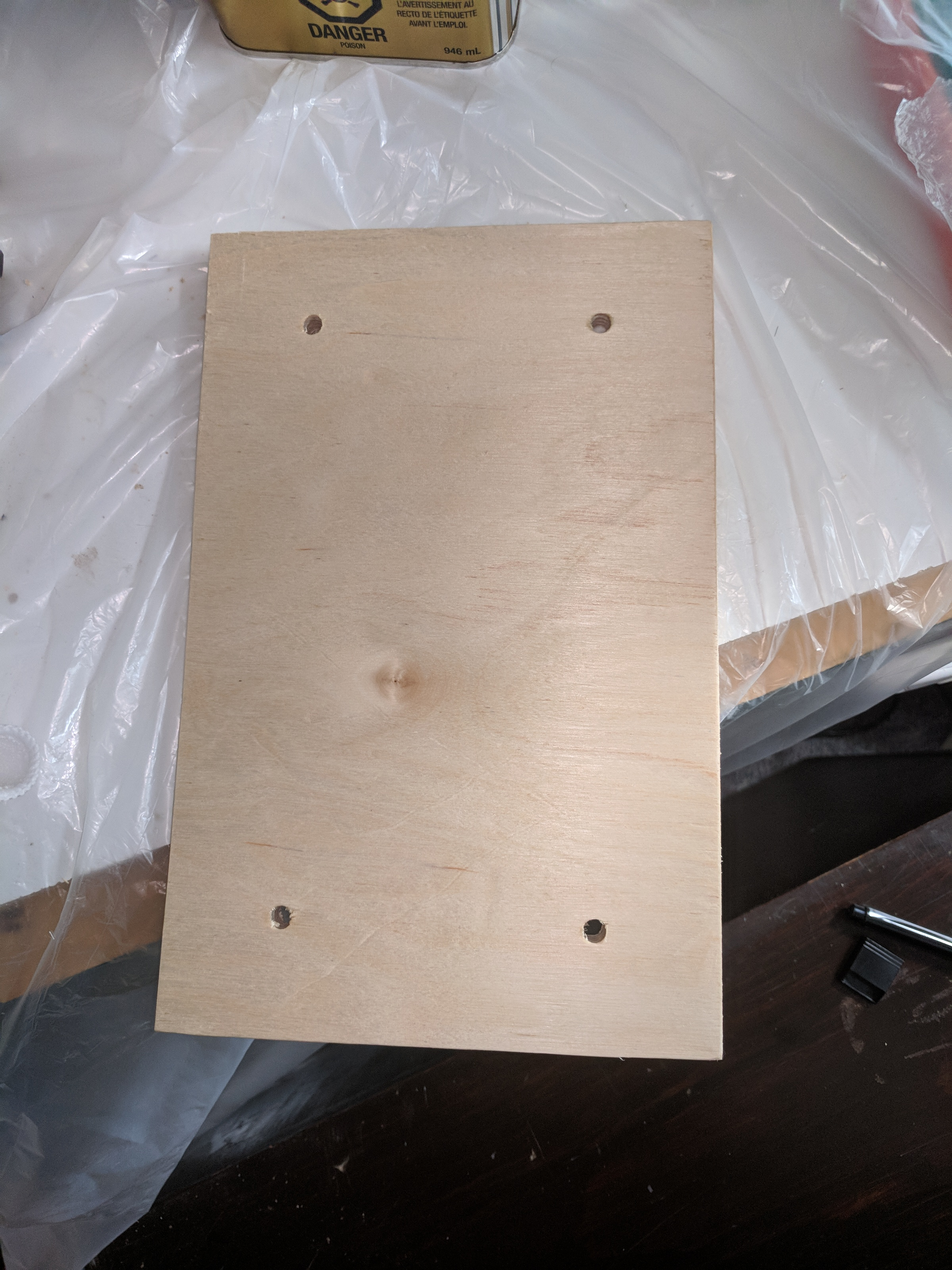 VESA holes cut in plywood